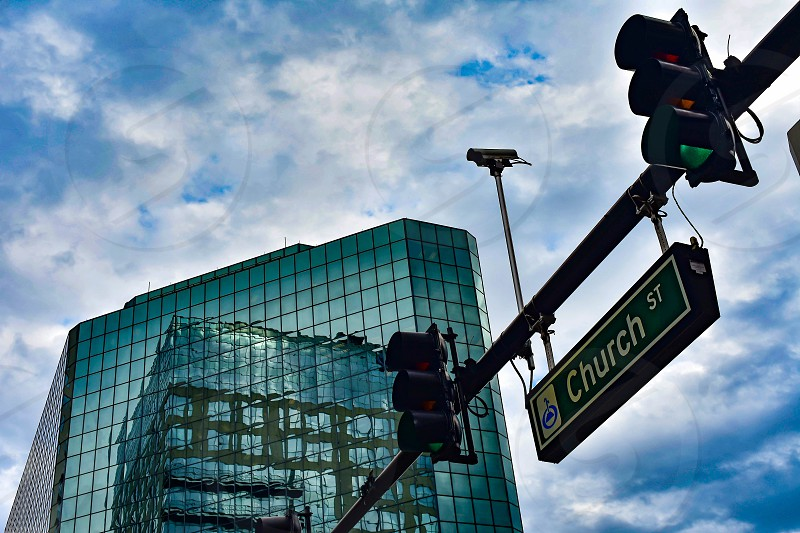Orlando Florida . December 24 2018. Top view of building with mirrored glass in Church street on blue sky cloudy background in Orlando Downtown area. photo