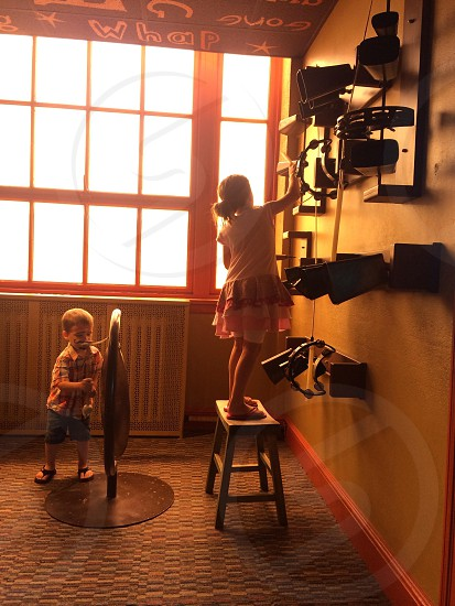 girl standing on wooden stool chair photo