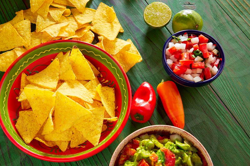 Guacamole with avocado tomatoes and nachos mexican food photo