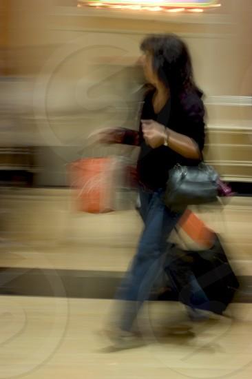 woman waling carrying a bag photo