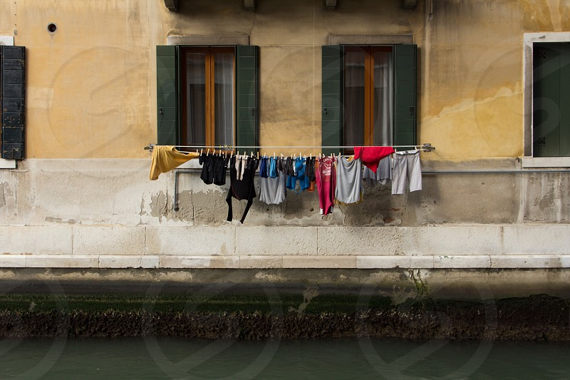 Laundry hanging along a canal Venice Italy. photo