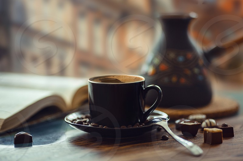 Coffee homeveranda story hot drink evening lay flat warm man morning table wood wooden spoon chocolate glass river muffin cocoa dark beans  coffeepot pot Turk spoon town city daylight  photo