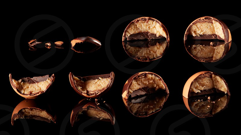 Soft chocolate covered candy filled with soft stuffing on a black background photo