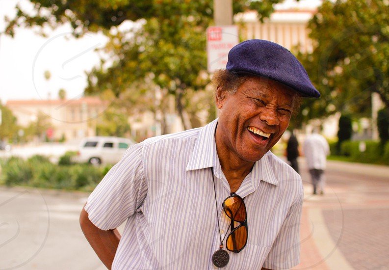 man in white and gray pinstriped top in shallow focus photography photo