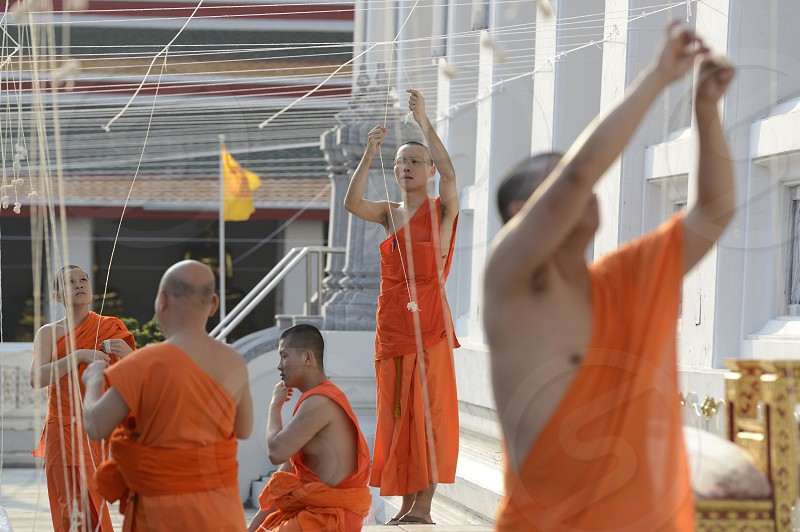 monks preparing the wat for the new year evening celebration in the temple of Wat Pho in the city of Bangkok in Thailand in Southeastasia. photo
