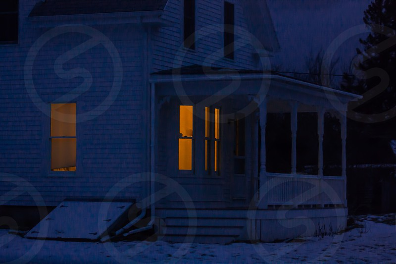 home warmth winter twilight blue gold white black welcome maine photo