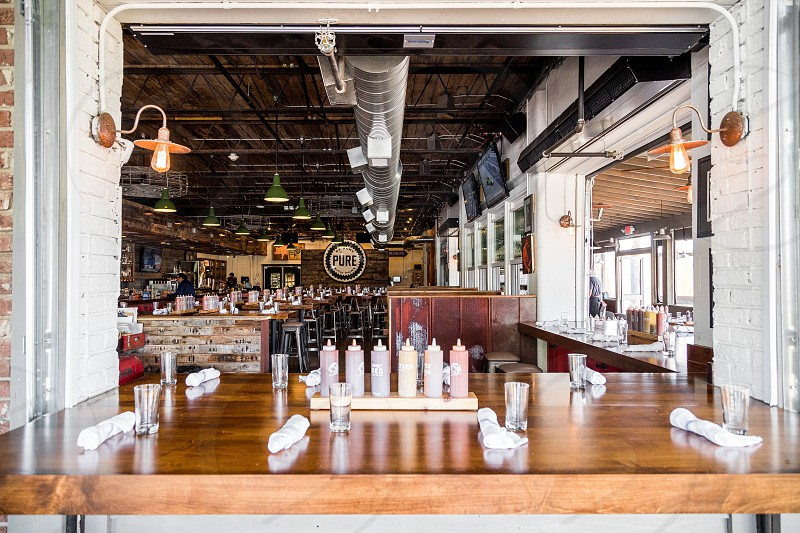 Open BBQ space with sauce at every table. photo