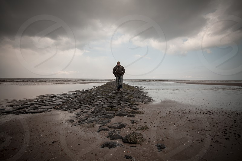 man standing on rock photo