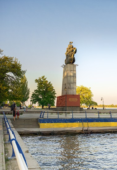 Kherson Ukraine - 04.27.2019. Monument to the first shipbuilders in Kherson in the spring evening photo