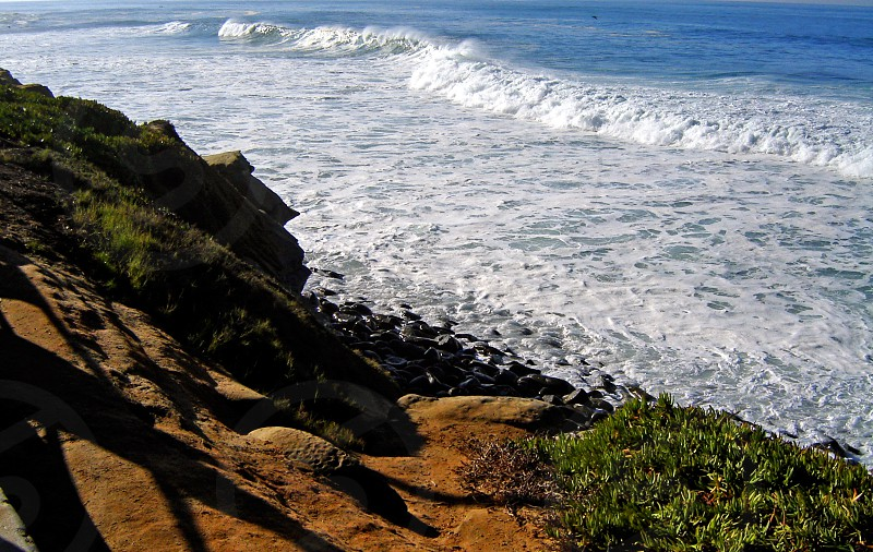 Rocks and waves on the Pacific Ocean photo