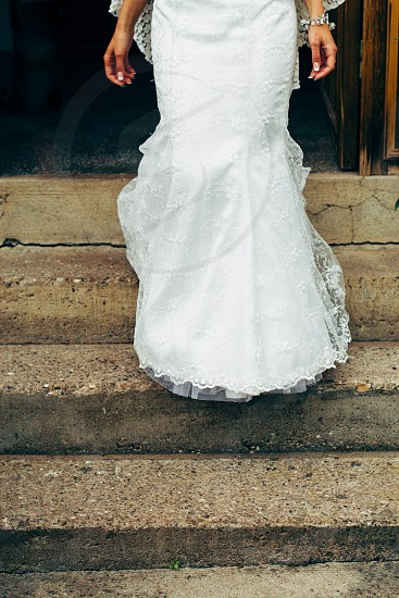 Bride coming down the stairs photo