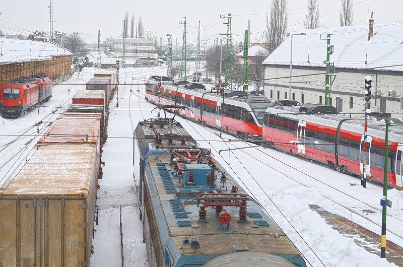 cargo carriage container deliver delivery depot europe european freight goods industrial industry logistics many mass move platform rail railing railroad railway station steel terminal track tracks traffic train transit transport transportation travel wagon snow winter white photo
