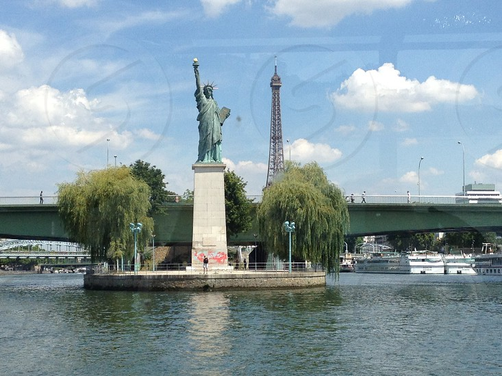 Statue of Liberty and Eiffel Tower in Paris.  photo