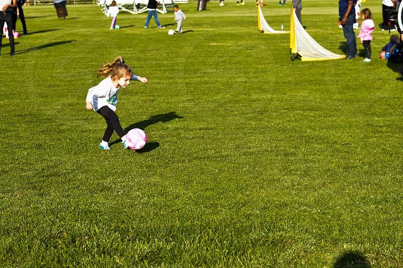 Soccer child pink ball photo