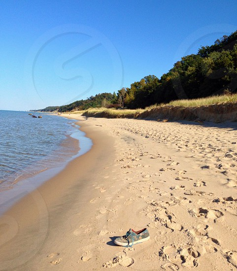 Abandoned shoe on a Lake Michigan beach. photo