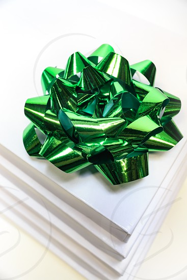 Now ribbon green box gift stack holiday package presents  photo