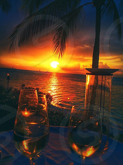 Romantic dinner at sunset. photo