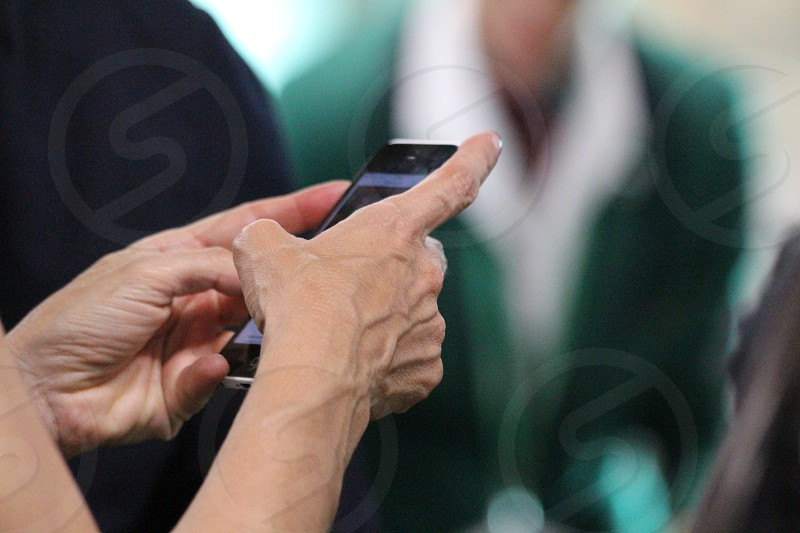 Hand's woman typing a message at smartphone photo