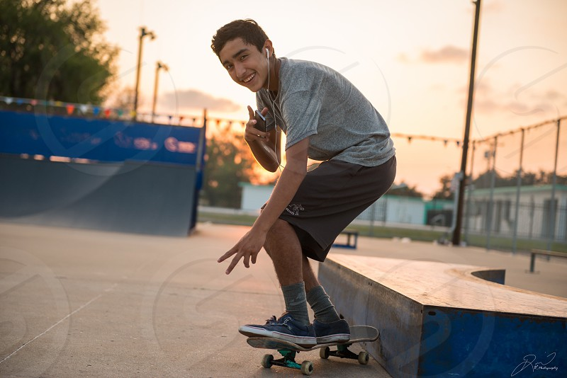 Skating teenager teen boy fun park sunset portrait photo