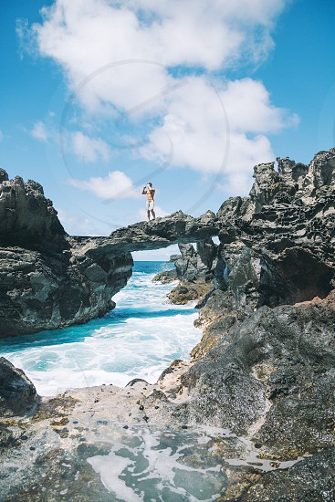 A crazy climb in Maui HI led us to this natural bridge made of lava rock. photo