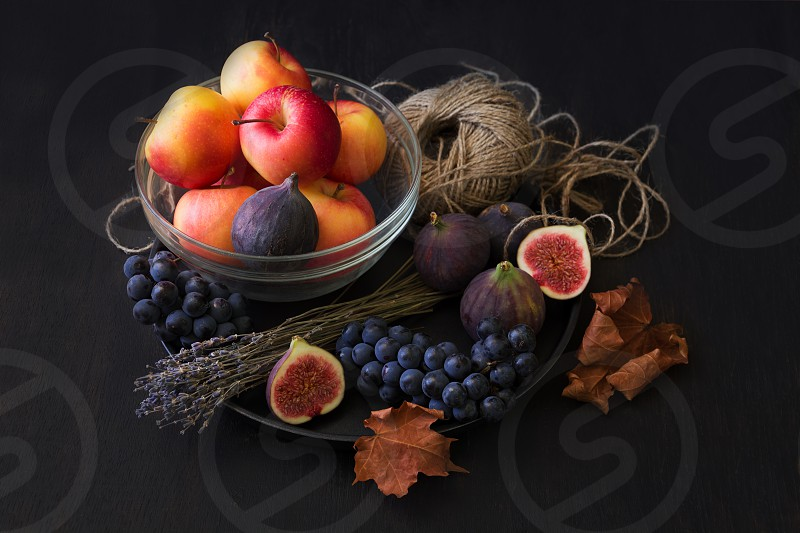 autumn fruits apples grapes figs  photo