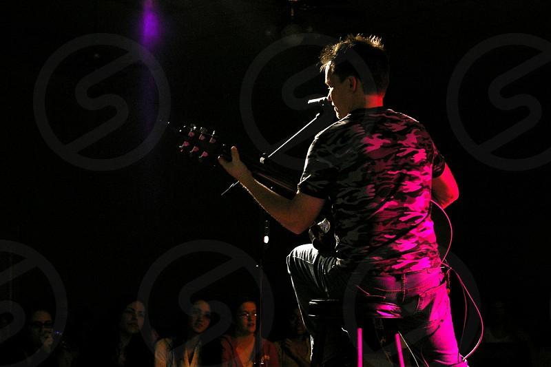 man with a guitar doin concert  photo