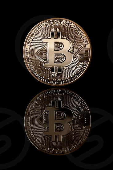 Virtual money bitcoin coins. Bitcoin gold coin from face side isolated on black background. Business concept. Bitcoin cryptocurrency. photo