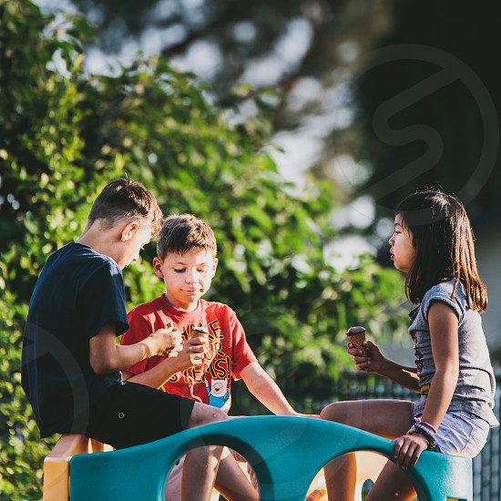 two boy and girl playing photo