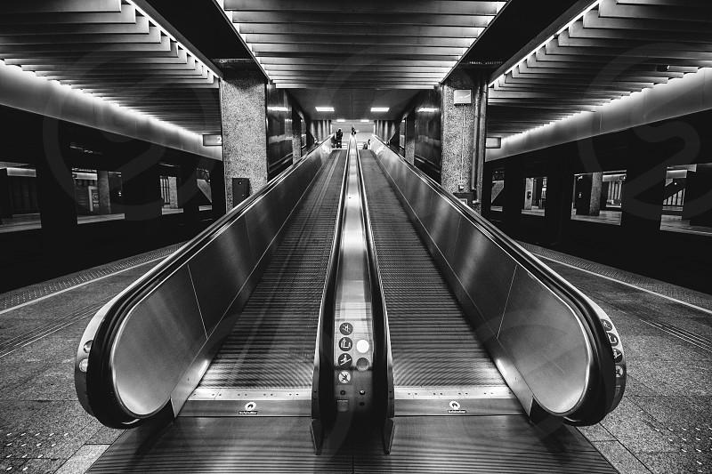 Escalators at a train station late at night photo