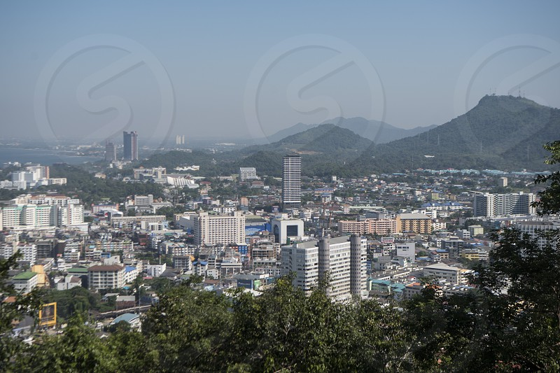 the city view from the Wat Khao Phutthakhodom Hill in the Town of Si Racha in the Provinz Chonburi in Thailand.  Thailand Bangsaen November 2018 photo