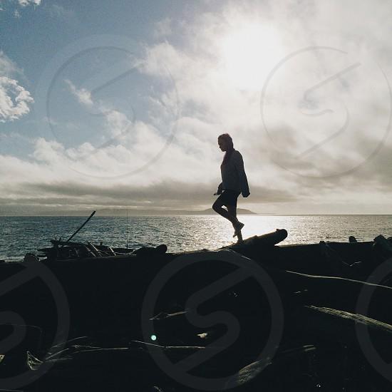 Silhouette girl beach movement photo