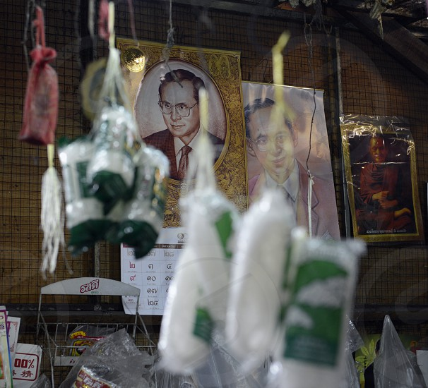 a pictures of the king Bhumibol on a market in the city of chiang mai in the north of Thailand in Southeastasia.  photo