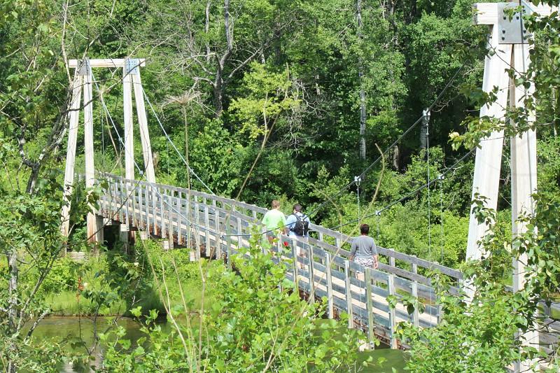 Hiking travelbackpacking manistee River trail bridge suspension bridge  photo