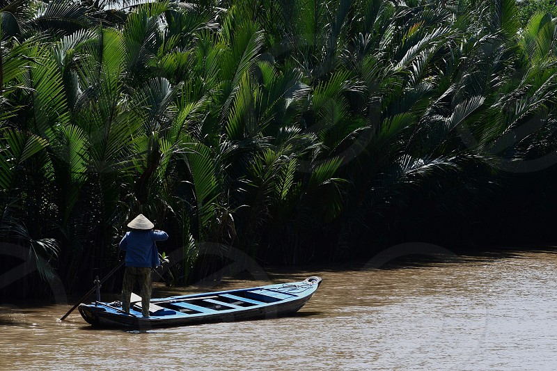 Sampan on the Mekong delta in Vietnam photo