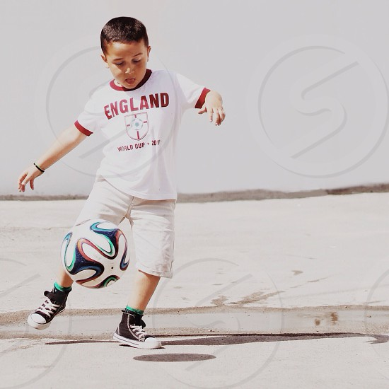 boy playing soccer photography photo
