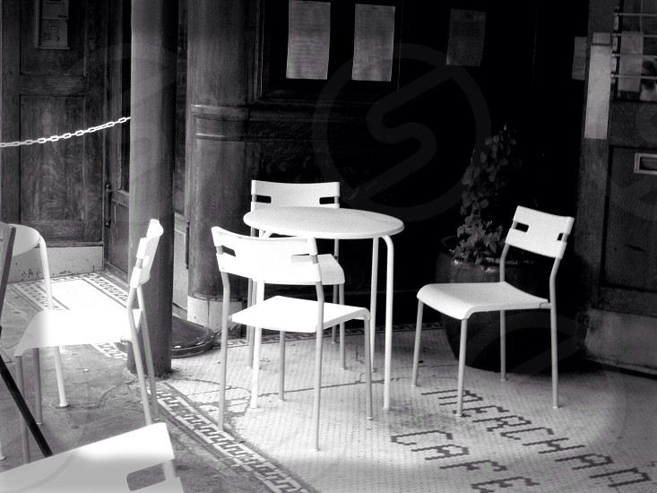 Black and white of empty chairs and tables at a Seattle cafe. photo