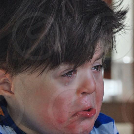 weeping brunet child photo