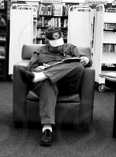 Cortex cam app. Taken inside books a million with a really interesting Vietnam vet doing some reading. iPhone 5s this time decided to go with black n white. photo