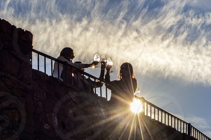 Two lens flares/ sun flares in one shot! Sonoma California wine tasting in the evening with friends. photo