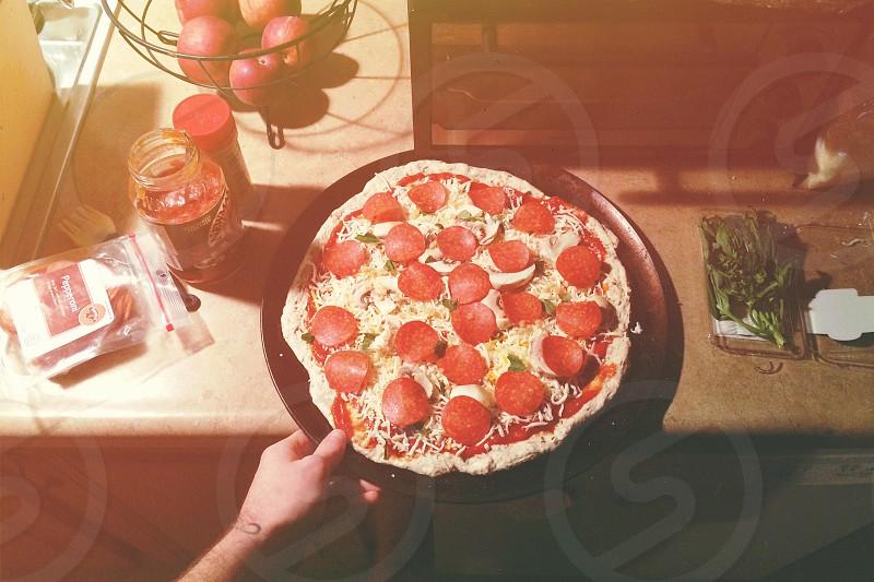 pepperoni pizza on black tray photo