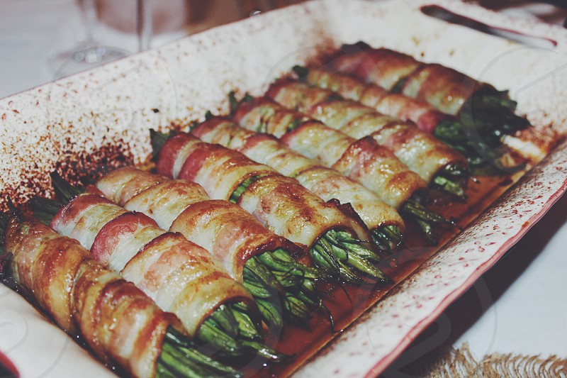 vegetables wrapped in bacons with sauce photo