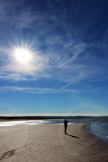 person standing on a beach photo