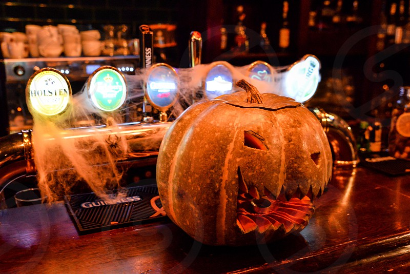 Halloween pumpkin lantern spider web spooky orange nightclub party autumn decoration fall night fun boo photo