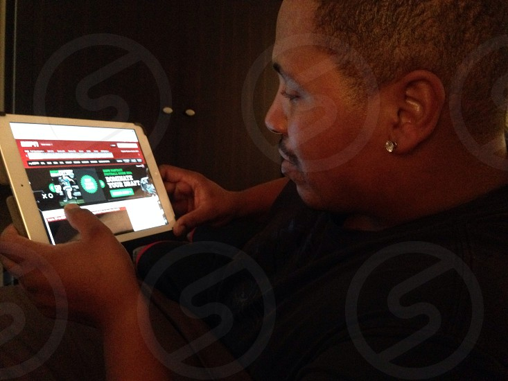 iPad  husband watching ESPN... Sports crazy ... photo