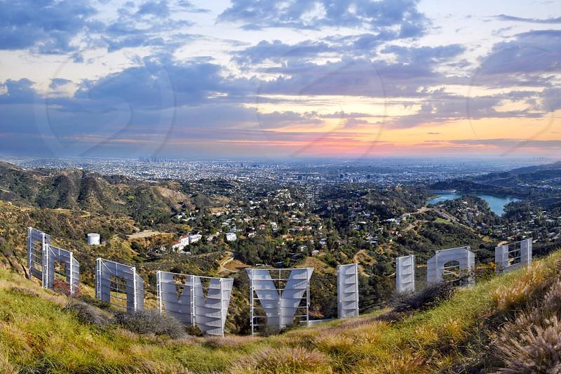 hollywood signage near cityscape during daytime photo