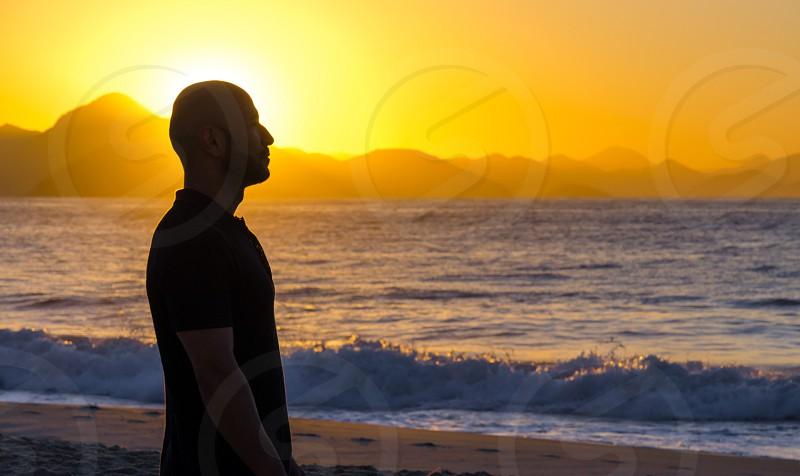 Young male on Copacabana Beach during sunrise Rio de Janeiro Brasil.  photo