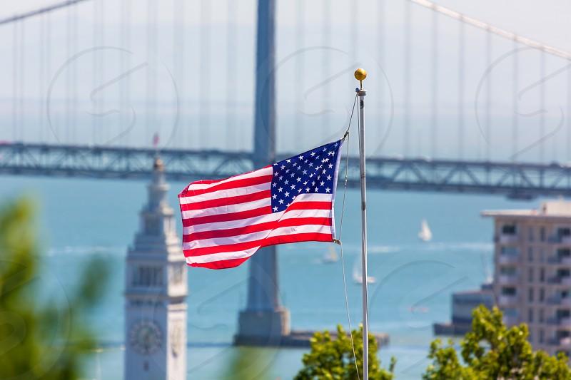 San Francisco USA American Flag Bay Bridge and Embarcadero Clock Tower from Telegraph Hill photo