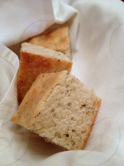 Foccaccia bread in napkin-wrapped basket photo