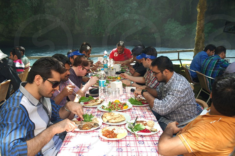 A group of people enjoying Turkish food in Duden Turkey. photo
