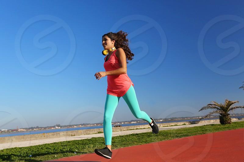 woman latin hispanic workout fitness running photo